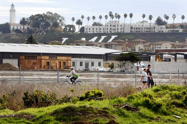 "Pedestrians and cyclists utilize the path that runs along Ballona Creek that is fenced off from ""Area C"" of the Ballona Wetlands between Marina Del Rey and Playa Vista that may become home to a new interpretive center."
