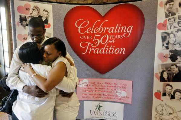 Gwendolyn Palmer (L) hugs her newly married daughter Michelle L. Palmer-Freeman and son-in-law Malcolm E. Freeman after the two were married today at Windsor Town Hall. This is the fiftieth year the Town has offered free weddings on Valentine's Day.