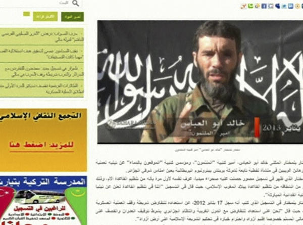 Veteran jihadist Mokhtar Belmokhtar is seen in a still image taken from Mauritanian news website Sahara Media at an unidentified location on January 20, 2013. Belmokhtar claimed responsibility on behalf of al Qaeda for the Algerian hostage crisis, a regional website reported on Sunday, tying the bloody desert siege to France's intervention across the Sahara in Mali. Algeria said it expected to raise its preliminary death tolls of 23 hostages and 32 militants killed in the four-day siege at a gas plant deep in the Sahara.