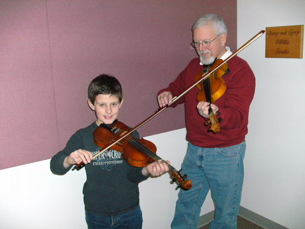 Richard O'Leary of Charlevoix and his grandson, Aaron O'Leary of Petoskey, practice in preparation for their first time at the Great Lakes Chamber Orchestra's Day for Music workshop. Both are students of Maggie Poxson who teaches at the Crooked Tree Arts Center in Petoskey. This year's Day for Music event will take place on Saturday, Feb. 2, at Charlevoix High School.
