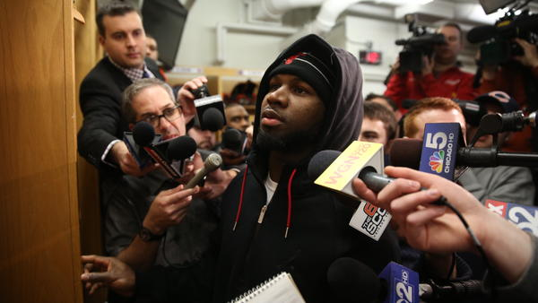 Devin Hester cleans out his locker while surrounded by reporters on New Year's Eve.