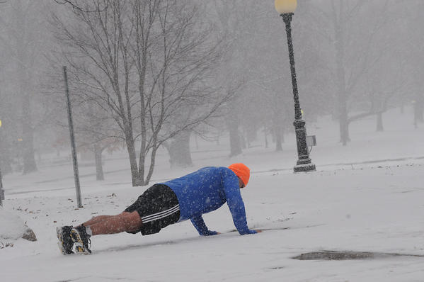 HARTFORD--1/28/13--Kevin Turko of Middletown did not let the snow deter him from his workout, which consisted of running and push ups in Bushnell Park before returning to work at a downtown law firm on a snowy day in Hartford Monday.
