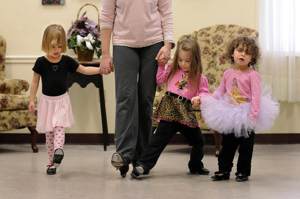 PORTLAND 01/29/13 Riley Flaum, 3 1/2, Cassi Hodge,3, and Kelsey Hamel, 3, (l-r) all of Portland, follow the lead of dance teacher Alicia Currier in a pre-school tap class at the Portland Senior Center. Currier teaches the class through the Portland Parks and Recreation department Tuesday afternoons at 2:00 p.m.