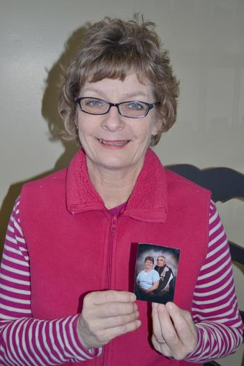 Brenda Short holds a photo of Kaye and Ronald Luster, a family she served as a Heritage Hospice volunteer. She enjoys her role of providing companionship and listening to patients' stories.