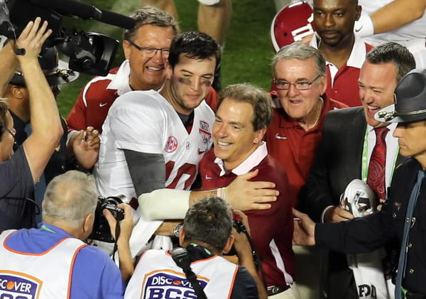 Alabama Crimson Tide head coach Nick Saban and quarterback A.J. McCarron (10) celebrate after the 2013 BCS Championship game against the Notre Dame Fighting Irish at Sun Life Stadium. Alabama won 42-14. Mandatory Credit: Robert Mayer-USA TODAY Sports