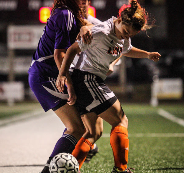 Oviedo's Emily Kobryn (4) battles Fletcher's Kayla Hancock (6) during first half action of a Class 5A girls soccer region final against Neptune Beach Fletcher in Oviedo, Fla. on Tuesday, January 29, 2013.