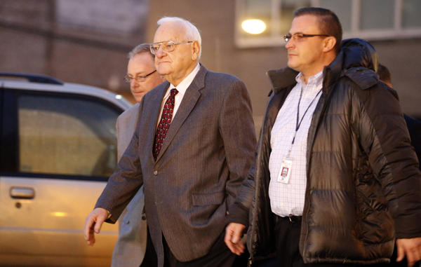 Former Gov. George Ryan is escorted to a halfway house in Chicago this morning.