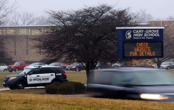 A Cary police car sits out front of Cary-Grove High School in Cary, Ill., before a code red drill takes place today.
