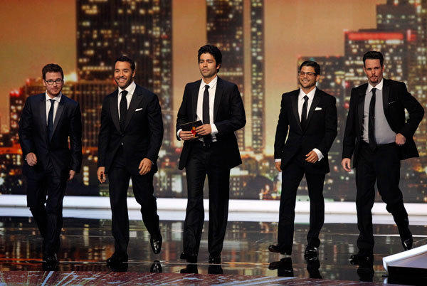 "The cast of ""Entourage"" present the Emmy award for outstanding writing for a miniseries, movie or a dramatic special at the 63rd Primetime Emmy Awards in Los Angeles September 18, 2011."