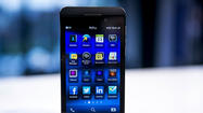 RIM unveils BlackBerry 10, two smartphones, new name; shares dive [Live video chat]