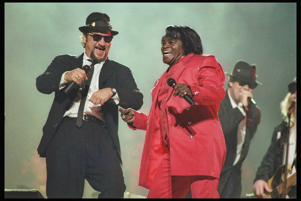 John Belushi (left) and James Brown perform in the half time show during Super Bowl XXXI at the Louisiana Superdome in New Orleans, Louisiana on January 26, 1997. The Packers beat the Patriots 35-21