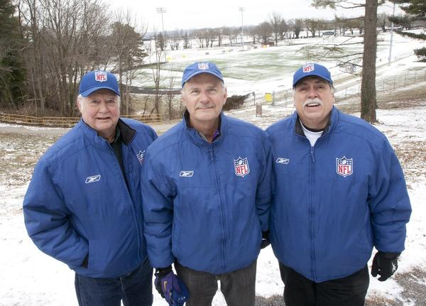 From left, Joe Cook, Bob Wobbeking and Mike Schumann are sideline officials for the Ravens chain crew. Although they won't be working at Super Bowl XLVII, they will root for the Ravens while watching the game on TV and keeping an eye on fellow officials.