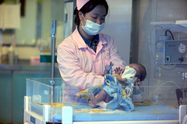 This picture taken on December 18, 2012 shows a nurse looking after a rescued baby in a hospital in Xichang, southwest China's Sichuan province.