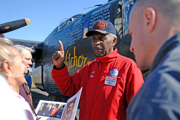 Ezra Hill, one of the Tuskegee Airmen and recipient of the Congressional Gold Medal, spoke to the crowd of people about his important contribution during World War II at Anthony Aviation on February 5, 2009.  Many people turned out to view the vintage World War II aircraft on display courtesy of the Collins Foundation.