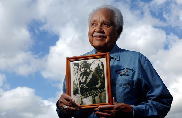 Retired Lt. Col. Leo Gray, 82, a retired Tuskegee Airman, holds a 1945 photo of himself after flying a mission over Europe.  Gray is one of 300 who will be awarded the Congressional Gold Medal by President Bush on March 29 in Washington, D.C.