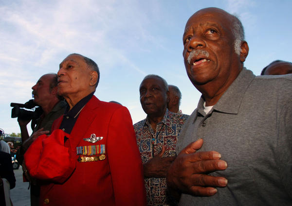 Tuskegee Airmen including Lee Archer, left and Herbert Jones, right, say the pledge of allegiance after arriving in Polk City Friday, August 19, 2005.