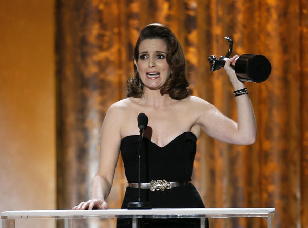 "Tina Fey accepts the award for outstanding female actor in a comedy series for her role in ""30 Rock"" at the 19th annual Screen Actors Guild Awards."