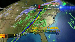 Storm system rumbles toward East Coast; tornadoes in South kill 2