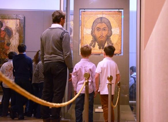 A family views religious art at the Tretyakov Gallery in Moscow.