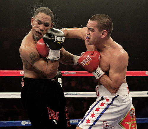 Carlos Molina (right) connects in a fight against James Kirkland in March 2012.