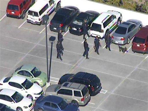 This frame grab provided by abc15.com shows the scene at a Phoenix office complex where police say a gunman shot at least three people on Wednesday. Officer James Holmes said the victims were taken to hospitals and did not know if their injuries were life- threatening.