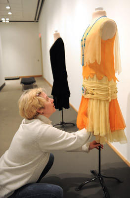 Kayla O'Connor, the Adjunct Textile Curator, put a flapper dress in the exhibit room at the Allentown Art Museum. The fashions were donated by Ellie Laubner, of Allentown, to the Museum. There will be a Fabulous Flappers exhibit a the Museum from February 3 - April 14.