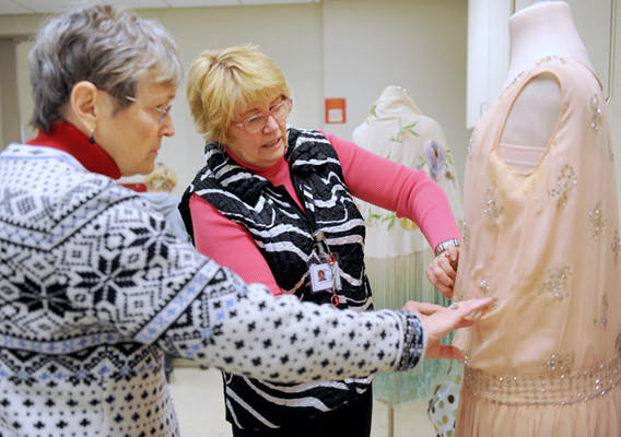 (L to R) Ellie Laubner, of Allentown, and Debbie Heeps, of Fogelsville and a SOTA member, work on a flapper dress donated by Ellie to the Allentown Art Museum. There will be a Fabulous Flappers exhibit a the Museum from February 3 - April 14.