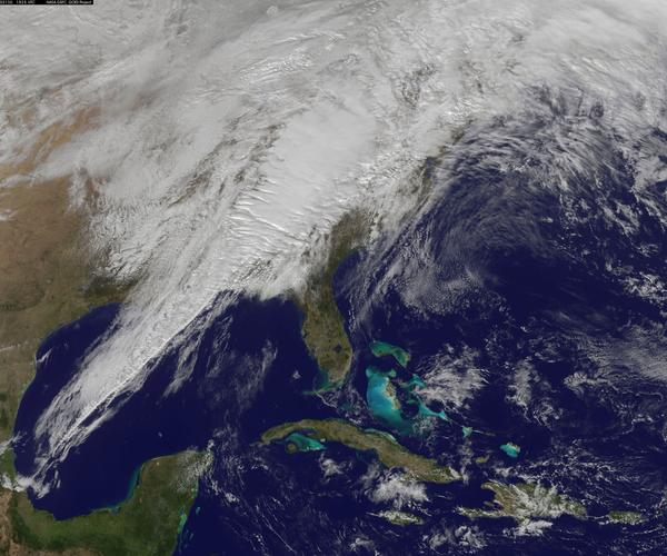 A storm system responsible for at least one death is seen moving across the eastern U.S. in this satellite photo taken by NASA and National Oceanic and Atmospheric Administration satellite.