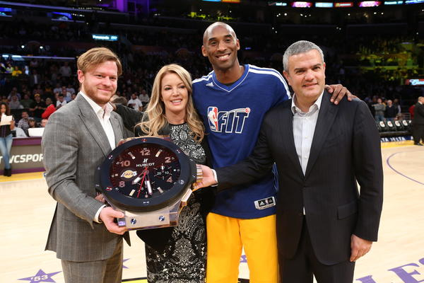 "Swiss luxury watch brand Hublot was announced as the ""first-ever official timekeeper: of the Los Angeles at a center-court ceremony that included, from left, Greg Simonian, president of the Beverly Hills boutique; Lakers executive Jeanie Buss; Lakers star Kobe Bryant; and Hublot Chief Executive Ricardo Guadalupe."