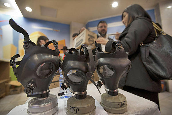 Gas mask kits are distributed at a mall in East Jerusalem. Thousands of Israelis reportedly are renewing their masks amid reports of an Israeli strike on Syria.