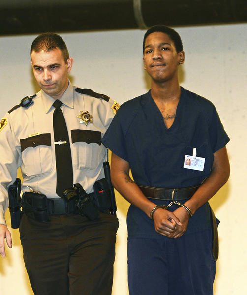 Hanson Gordon, 18, is walked to his preliminary hearing in Lehigh County Courthouse Wednesday morning. He is charged with attempted homicide for shooting into a crowd of Allen High School students, striking two.