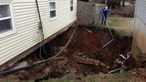 Old mine shaft opens hole between, under homes in east Springfield