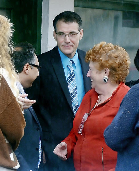 Terry Porter, middle, talks with his attorney, Rob Kamrad, left, and a family member after a preliminary hearing Wednesday at Washington County District Court.