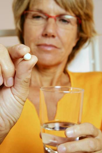 Woman taking medication as part of