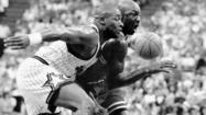 Simeon grad Nick Anderson, shown on left in this 1995 photo, defending Michael Jordan.