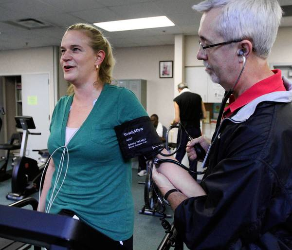 Russ Starrett, RN, takes vital signs of Sarah Batts while she works out at Cardiac Rehabilitation at Piedmont Hospital in Atlanta, Georgia, on October 25, 2012.