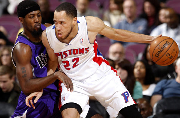 Pistons forward Tayshaun Prince, right, works in the post against Kings guard John Salmons.