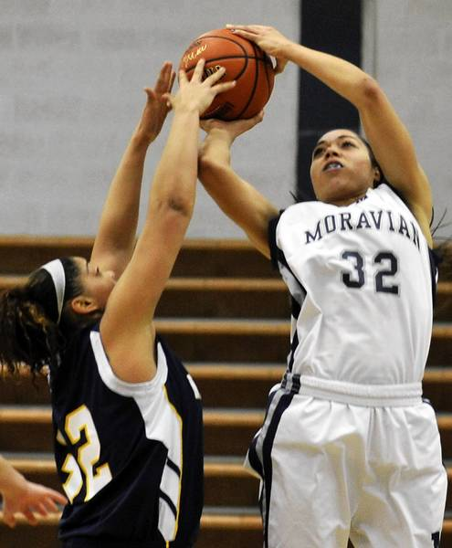 Moravian's Alexis Wright lays up for the basket as New Jersey's Candace Vigo reaches out for the ball on January 14, 2013.