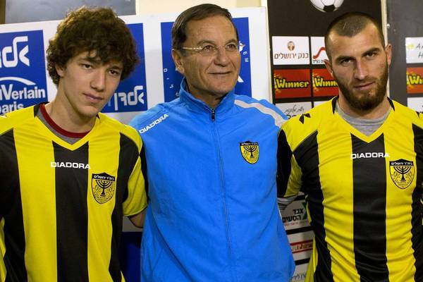 Beitar Jerusalem soccer coach Eli Cohen, center, stands with Gabriel Kadiev, left, and Zaur Sadayev of Chechnya in Jerusalem.