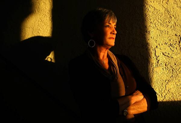 Long Beach teacher Lynne Nielsen protested after her insurance company was billed $87,000 for her routine knee surgery.