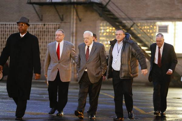 Former Gov. George Ryan walks to a halfway house in Chicago. Former Gov. James Thompson, right, joined Ryan this morning.