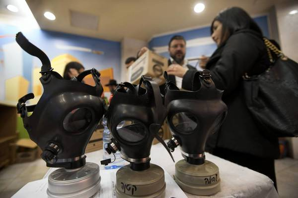 Israelis pick up gas mask kits from a distribution area in Pisgat Zeev, a neighborhood in East Jerusalem.