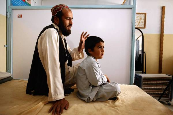 Five-year-old Muqadas was shot in the head during an exchange of gunfire between Taliban fighters and U.S. forces in Afghanistan. His father, Mohammed Anwar, took him to a U.S. base, and American medical care saved his life.