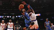 Orlando Magic's Nelson drives to basket past New York Knicks' Stoudemire during their NBA basketball game in New York