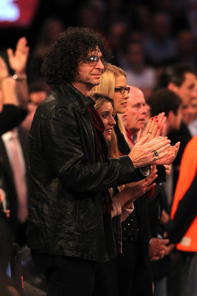 King of all media Howard Stern applauds before the start of an NBA game between the New York Knicks and the Orlando Magic at Madison Square Garden.