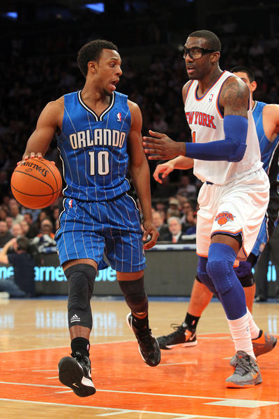 Orlando Magic guard Ish Smith (10) is defended by New York Knicks forward Amar'e Stoudemire (1) during the second quarter of an NBA game at Madison Square Garden.