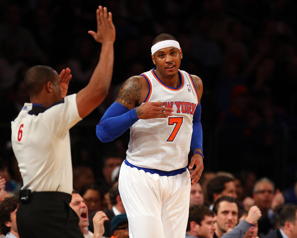 Carmelo Anthony #7 of the New York Knicks celebrates his three point basket in the first half against the Orlando Magic on January 30, 2013 at Madison Square Garden in New York City.