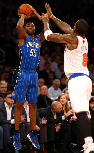 E'Twaun Moore #55 of the Orlando Magic takes a shot as J.R. Smith #8 of the New York Knicks defends on January 30, 2013 at Madison Square Garden in New York City