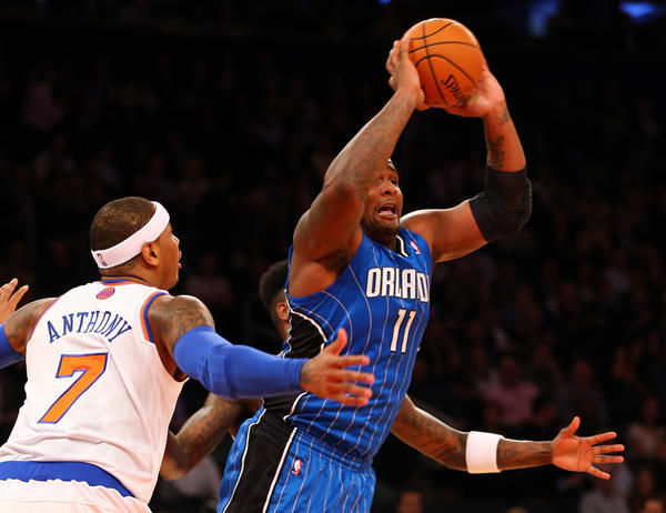 Glen Davis #11 of the Orlando Magic passes the ball as Carmelo Anthony #7 of the New York Knicks defends on January 30, 2013 at Madison Square Garden in New York City.