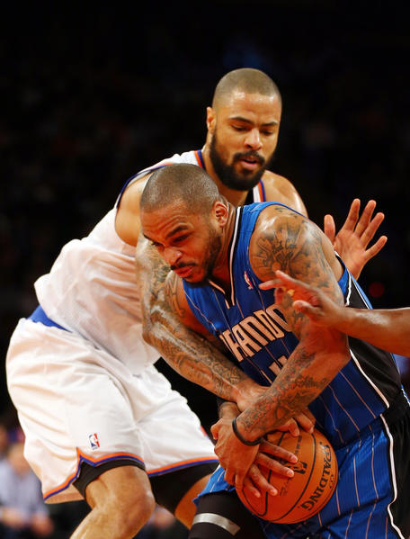 Jameer Nelson #14 of the Orlando Magic heads for the net as Tyson Chandler #6 of the New York Knicks defends on January 30, 2013 at Madison Square Garden in New York City.